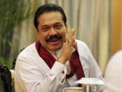 Sri Lanka's President Mahinda Rajapaksa speaks during a meeting with foreign correspondents at his office in Colombo