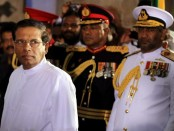 COLOMBO, SRI LANKA - JANUARY 09:  Sri Lanka's newly elected president Maithripala Sirisena (C) prepares to take oath as he is sworn in at Independence Square in Colombo on January 9, 2015 in Colombo, Sri Lanka. Sirisena will be the 7th President of the Democratic Socialist Republic of Sri Lanka.  (Photo by Buddhika Weerasinghe/Getty Images)