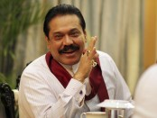 Sri Lanka's President Mahinda Rajapaksa speaks during a meeting with foreign correspondents at his office in Colombo January 31, 2012. Rajapaksa was emphatic: China's presence in Sri Lanka is strictly business, and not political. Challenged on speculation that China financed and built the $1.4 billion Mahinda Rajapaksa port on Sri Lanka's south coast so it could sneak a naval base into India's backyard, Rajapaksa laughed and said his giant neighbor had not complained. REUTERS/Presidential Media Office/Handout (SRI LANKA - Tags: POLITICS) FOR EDITORIAL USE ONLY. NOT FOR SALE FOR MARKETING OR ADVERTISING CAMPAIGNS. THIS IMAGE HAS BEEN SUPPLIED BY A THIRD PARTY. IT IS DISTRIBUTED, EXACTLY AS RECEIVED BY REUTERS, AS A SERVICE TO CLIENTS