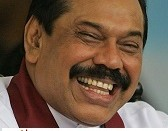 Sri Lankan President Mahinda Rajapaksa smiles during a ceremony to honor the soldiers who fought to defeat Tamil Tiger rebels in Colombo, Sri Lanka, Friday, May 22, 2009. (AP Photo/Eranga Jayawardena)