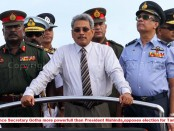 Sri Lankan Defence Ministry Secretary Gotabaya Rajapaksa (C) rides in a jeep with three forces commanders during a Victory Day parade rehearsal in Colombo on May 17, 2013.