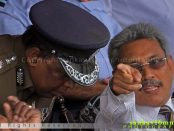 Sri Lankan Defence Ministry Secretary Gotabaya Rajapaksa (R) talks with Senior DIG Anura Senanayake during a Victory Day parade rehearsal in Colombo on May 17, 2013.