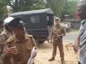 Inspector-Wanninayake-speaks-to-Prof-Jeevan-Hoole's-elder-brother-Dr.-Rajan-Hoole-with-Black-Maria-like-vehicle-WP-LF-0711-and-armed-police--1200x675