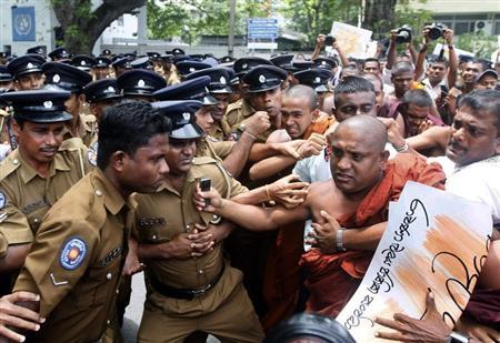 """Demonstrators from the """"Power of Ravana"""" organization clash with police officers during a protest against the visit by U.N. High Commissioner for Human Rights Pillay, in Colombo"""