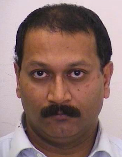Rupen Balaram-Sivaram, 51, of Toronto, is accused of threatening to kill high-ranking government, military and police officials in Ontario. (Toronto Police handout)