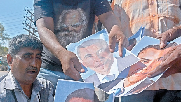 Cadre of TPDK burning pictures of US President Barack Obama after he backed an internal probe into alleged war crimes committed by the Lankan army during the Eelam War, in Coimbatore on Friday | Shankar Narayan